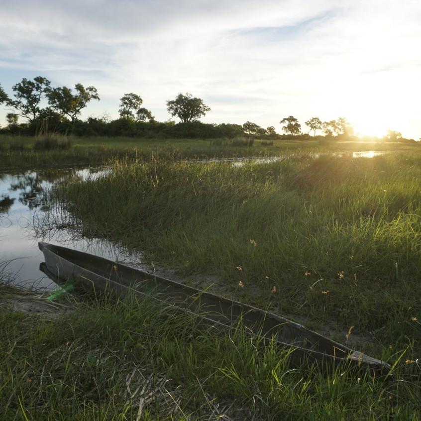 Mokoro at sunset in the Okavango Delta