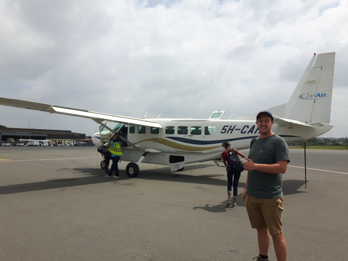 Lucas in front of Zanair aircraft