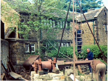 The Mines Museum Setting Up The Water Wheel