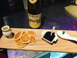 Caviar, warm Blinis, sour cream, & a sho