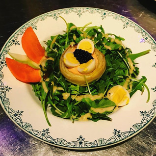 Artichoke Nest _ Artichoke Bottom, Our   cocktail sauce, quail eggs and Caviar; over fresh Organic Arugula all dressed up with our delicious
