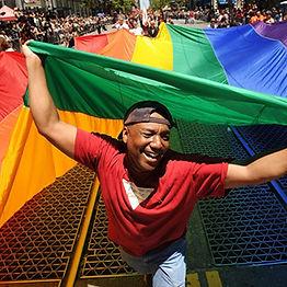 Black man with rainbow flag