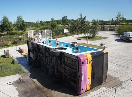 Artist Transforms Bus Into Swimming Pool