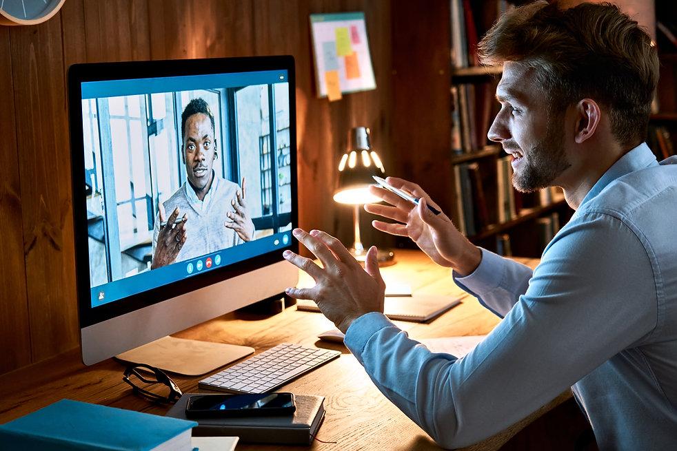 diverse-business-men-talking-on-video-co