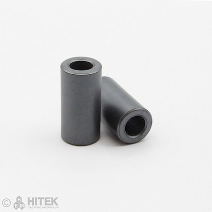 Pair of sleeve core ferrite beads measuring 14.27mm x 28.57mm x 7.26mm