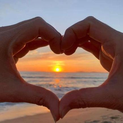 Campaign - hand heart sunset.jpg