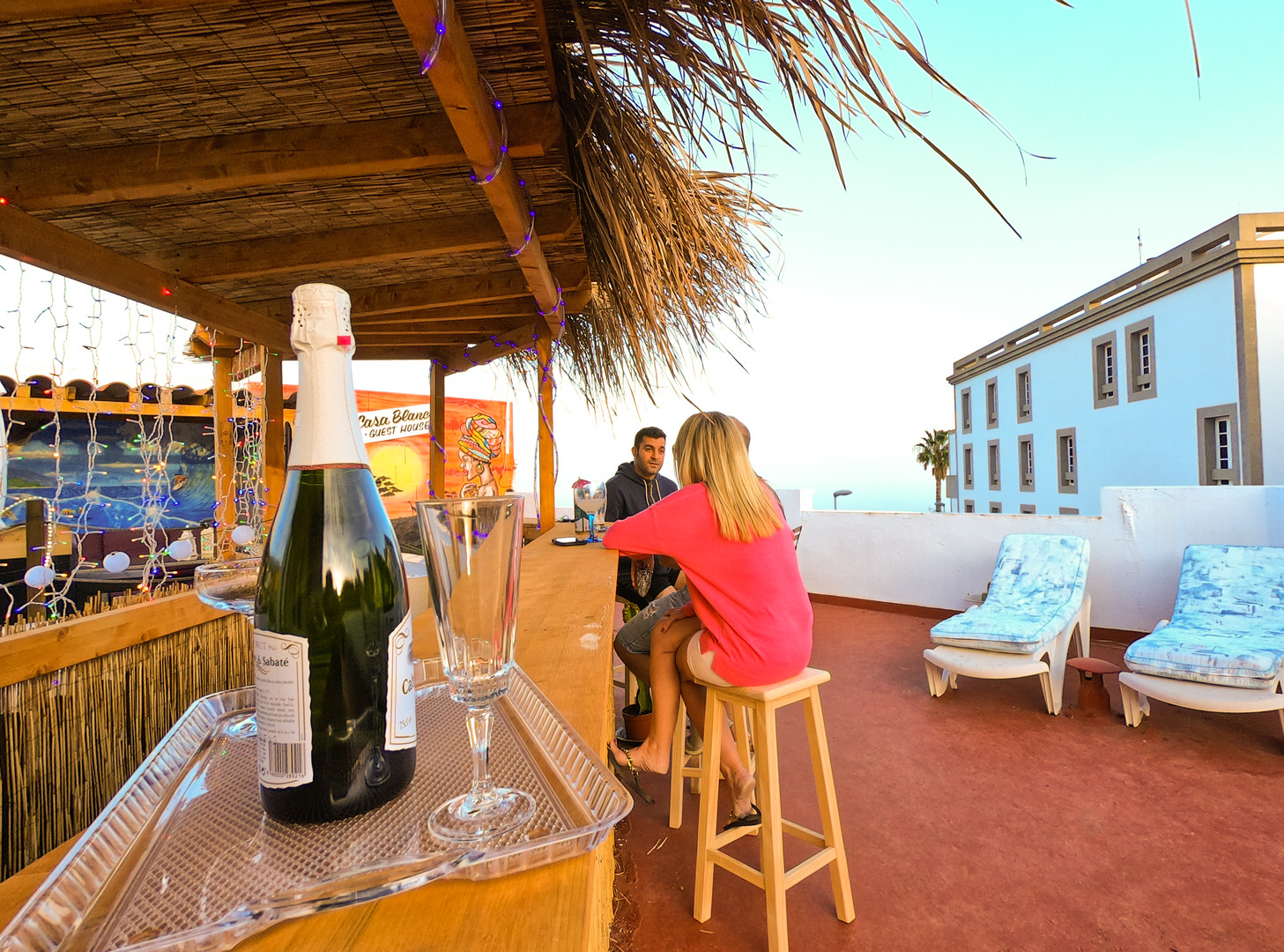 Casa Blanca Guest house Tenerife tiki bar with champagne and glasses on bar