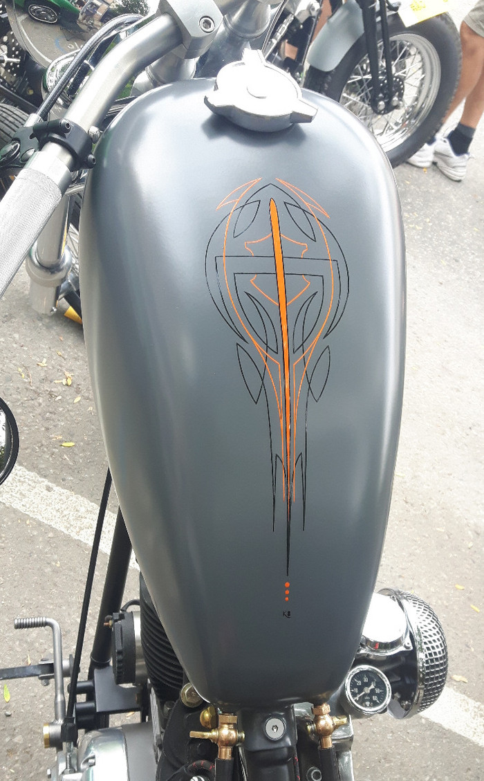 Pinstripe design on a modified Harley Davidson; tank and rear faring.