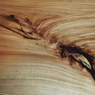 Elm Table Detail of filled knot
