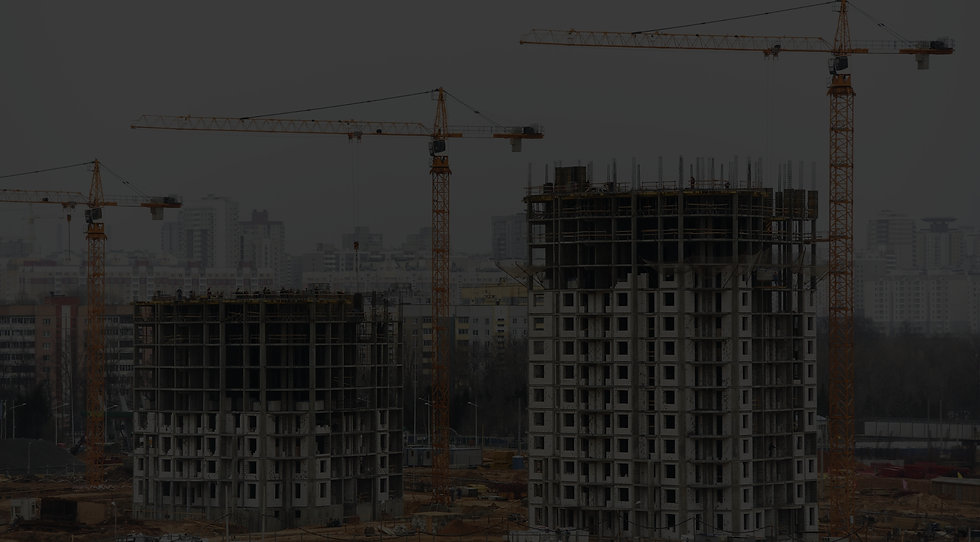 Multi-storey buildings being constructed.  Cranes in the background.