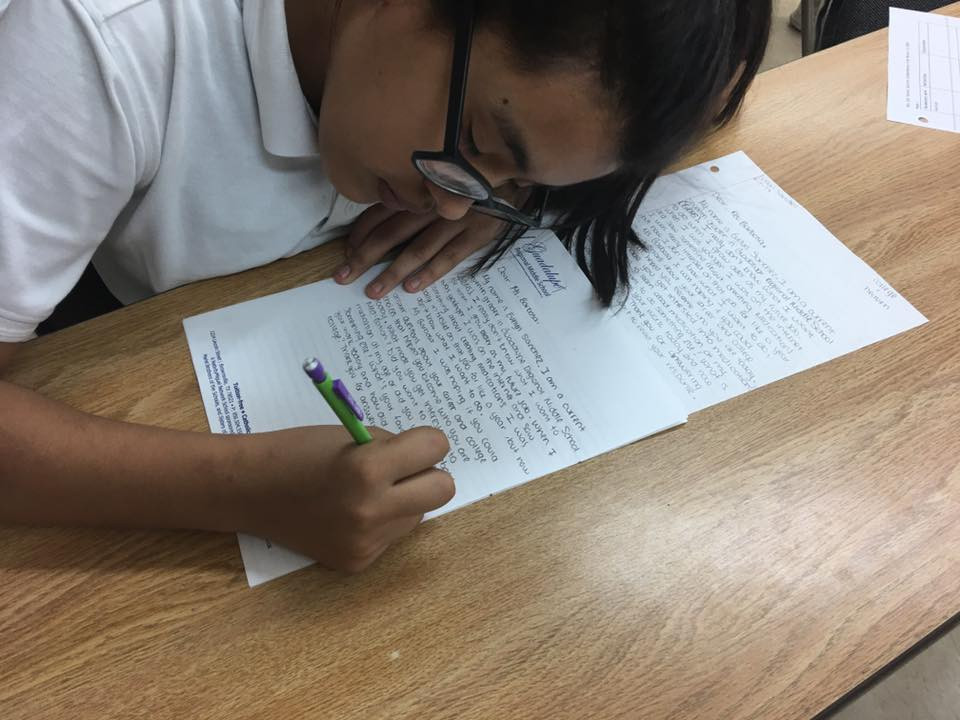 Student writing letter