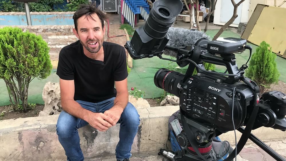 Interviewing skatepark designer Wade Treaven in downtown Sulaymaniyah. James Holman Film