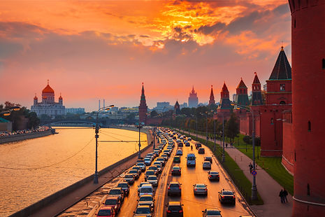 Traffic at sunset near Kremlin wall in M