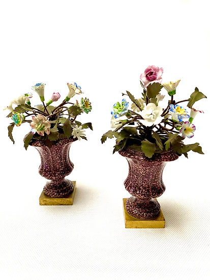 """Pair of Continental gilt-bronze mounted """"porphyry"""" porcelain vases with flowers"""