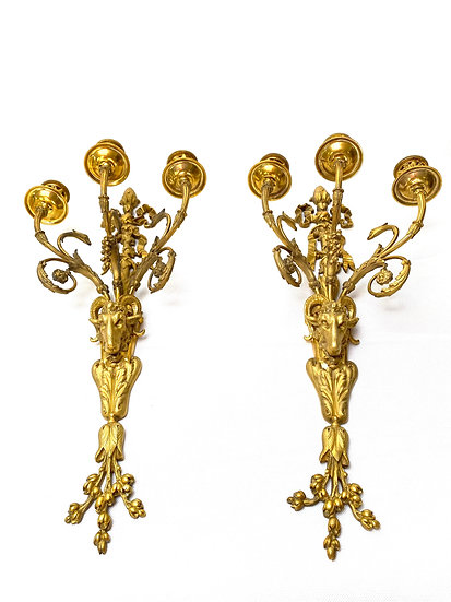 Pair of French 19th c gilt-bronze wall appliques with ram's heads