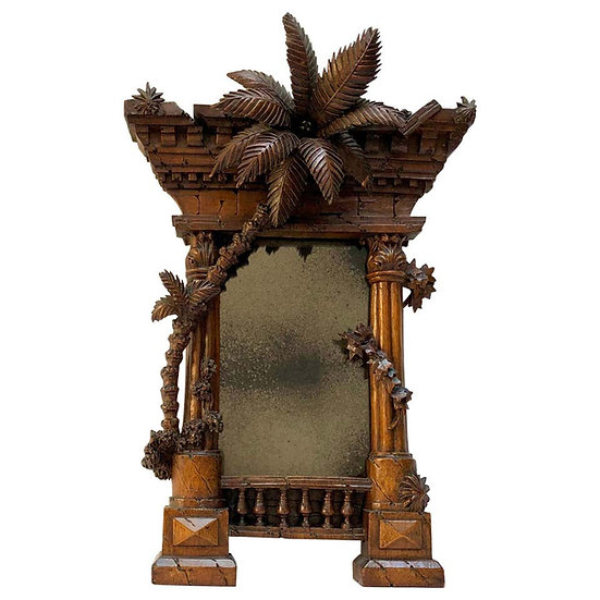 A French 19th c Orientalist carved walnut frame modelled as a Classical ruin