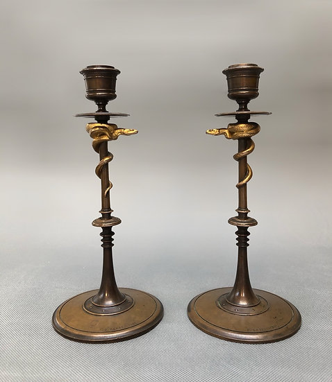 A pair of French 19th century bronze snake candlesticks by Barbedienne