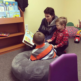 Jackie reading to boys in the nursery