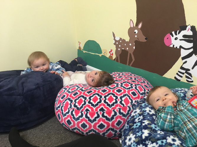 Babies lounging on the bean bag chairs in the Nursery