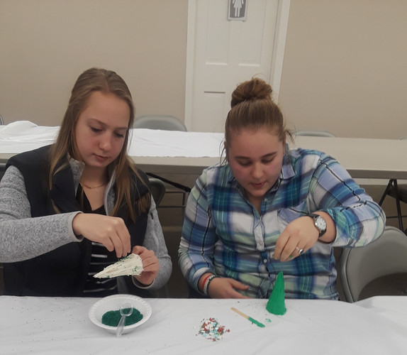 Abby & Kylie decorating their  ice cream cone Christmas trees at our PKC Christmas Party