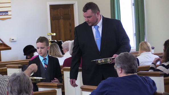 Father & son ushering together during Sunday Service