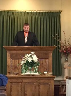 Chris sharing his testimony during Sunday Service
