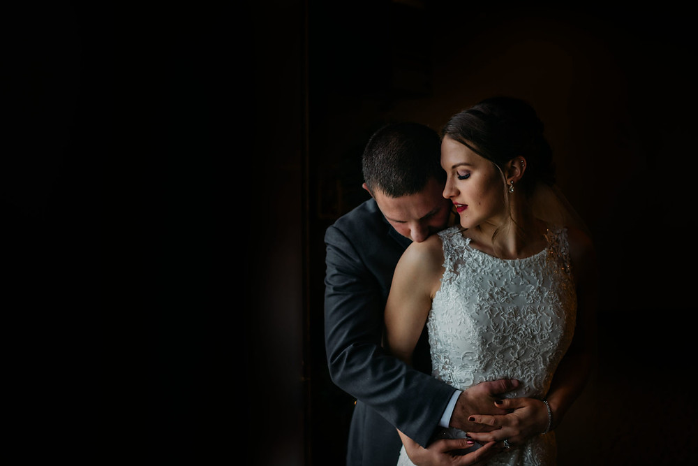 A groom kisses his bride on the shoulder before their romantic, stormy wedding at Hidden Meadows in Snohomish, a wedding venue near Seattle, WA. | My Snohomish Wedding | Snohomish Wedding Planning