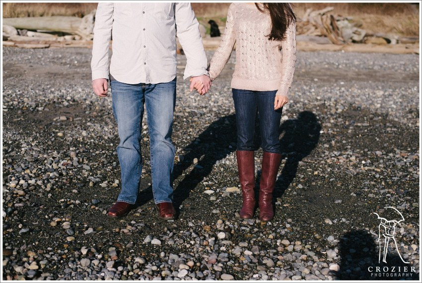 An engaged couple holds hands at the beach. | My Snohomish Wedding | Wedding planning near Seattle, WA.