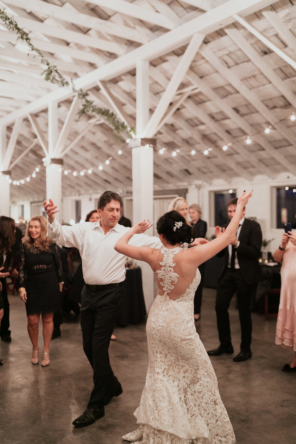 Photo of a bride dancing during the reception of her winter wedding at Dairyland in Snohomish, a wedding venue near Seattle, WA. | My Snohomish Wedding | Snohomish Wedding Planning