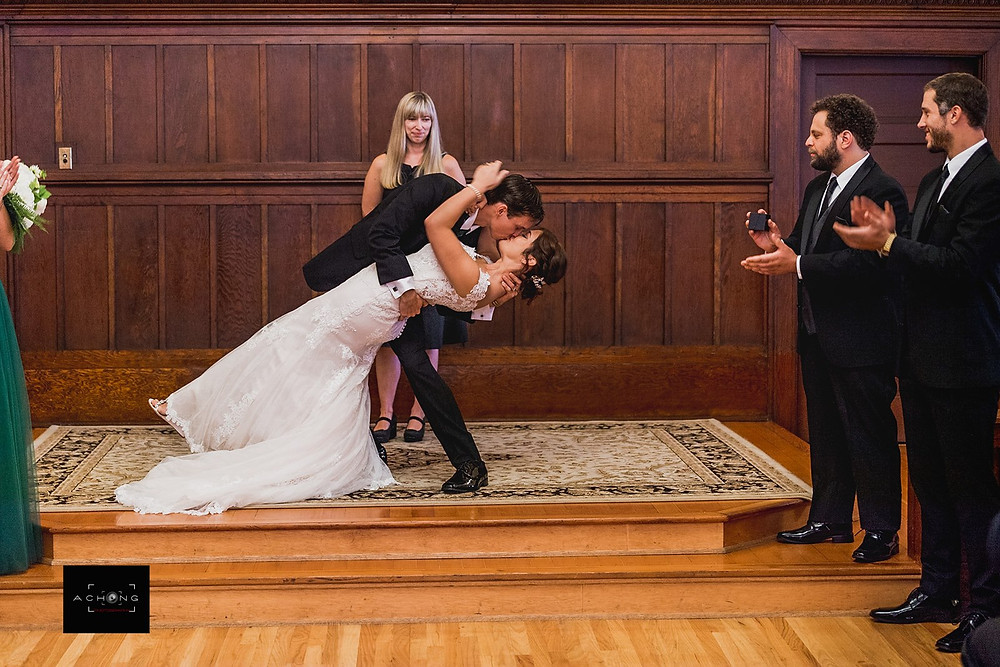 A photo of the first kiss during a wedding ceremony at The Feather Ballroom in Snohomish, a wedding venue near Seattle, WA. | My Snohomish Wedding | Snohomish Wedding Planning