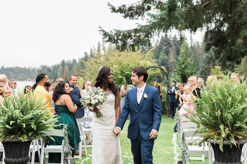A bride and groom walk down the aisle after their ceremony from an outdoor wedding at Green Gates at Flowing Lake, a wedding venue in Snohomish near Seattle, WA. | My Snohomish Wedding | Snohomish Wedding Planning