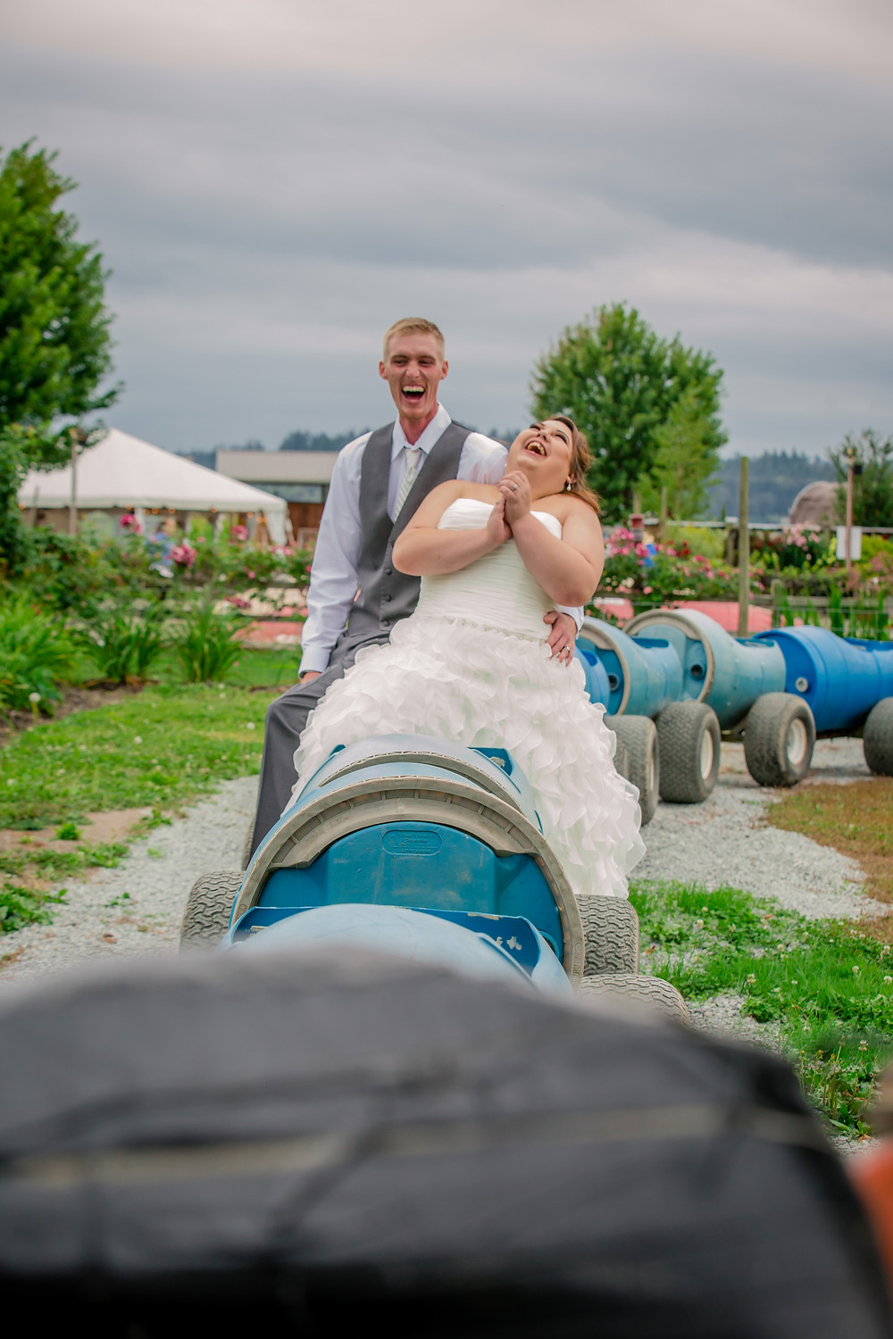 A bride and groom have fun before a wedding at the Red Barn at Stocker Farms in Snohomish, a wedding venue near Seattle, WA.