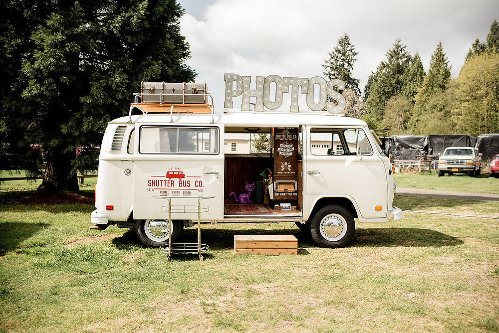 Shutter Bus Co, a photo booth, in front of rustic traveling wedding venue Tentwood barn. | My Snohomish Wedding | Snohomish Wedding Planning