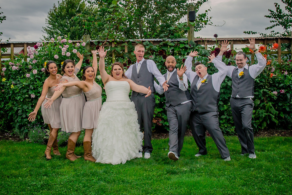 A wedding party strikes a fun pose before a wedding at the Red Barn at Stocker Farms in Snohomish, a wedding venue near Seattle, WA.