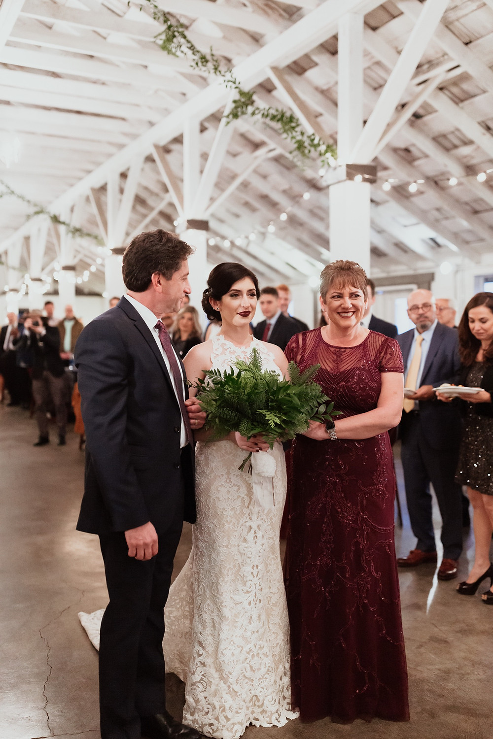 Ceremony photo of a bride walking down the aisle during her winter wedding at Dairyland in Snohomish, a wedding venue near Seattle, WA. | My Snohomish Wedding | Snohomish Wedding Planning