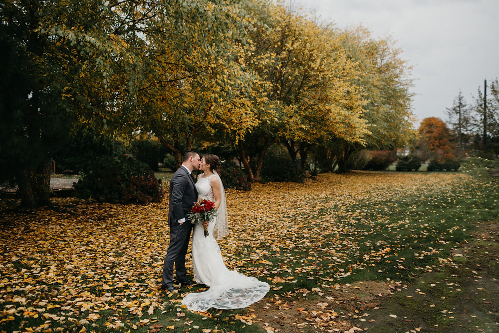 A newlywed couple kiss after their romantic, stormy wedding at Hidden Meadows in Snohomish, a wedding venue near Seattle, WA. | My Snohomish Wedding | Snohomish Wedding Planning