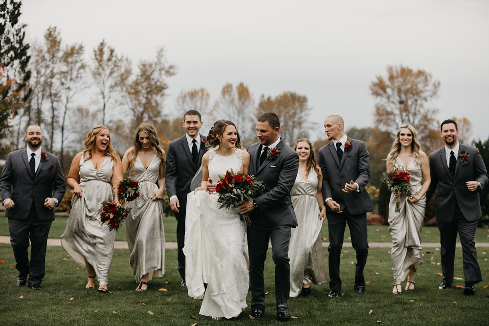 A newlywed couple and their bridal party at a romantic, stormy wedding at Hidden Meadows in Snohomish, a wedding venue near Seattle, WA. | My Snohomish Wedding | Snohomish Wedding Planning