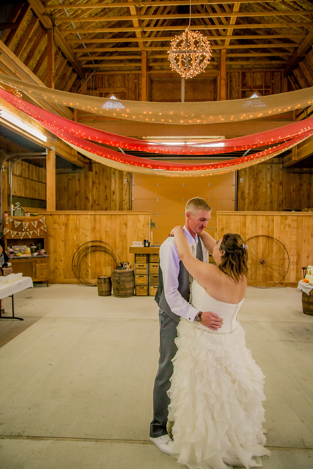 A groom dances with his bride during their wedding at the Red Barn at Stocker Farms in Snohomish, a wedding venue near Seattle, WA.
