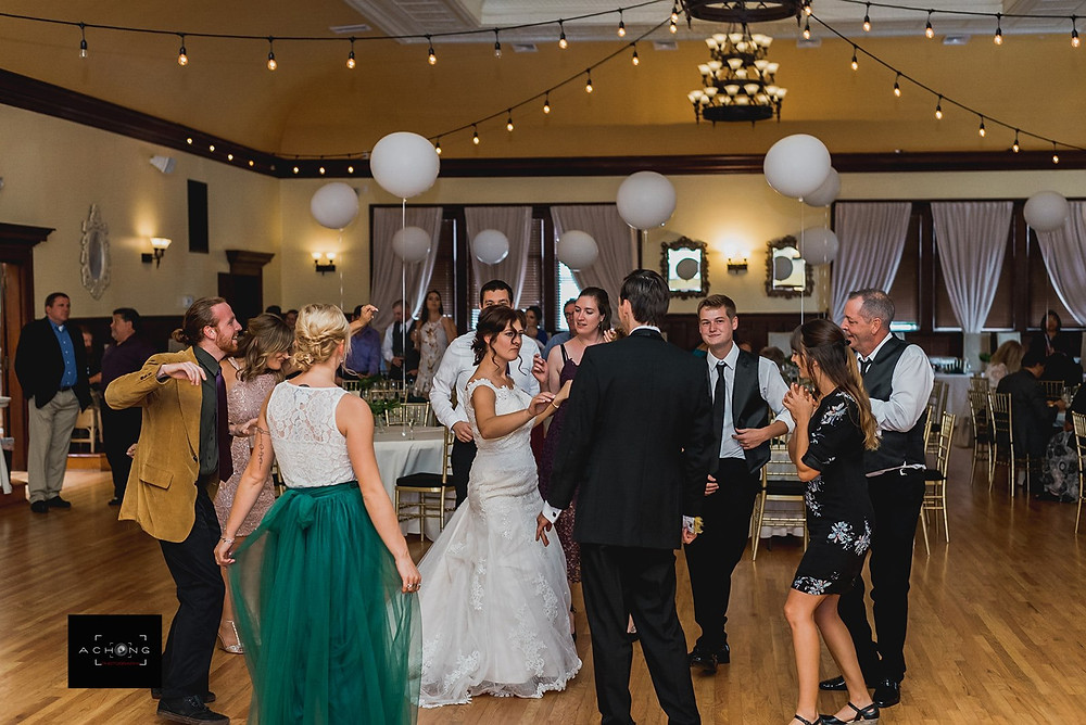A bride and groom dance with their guests during their reception at The Feather Ballroom in Snohomish, a wedding venue near Seattle, WA. | My Snohomish Wedding | Snohomish Wedding Planning