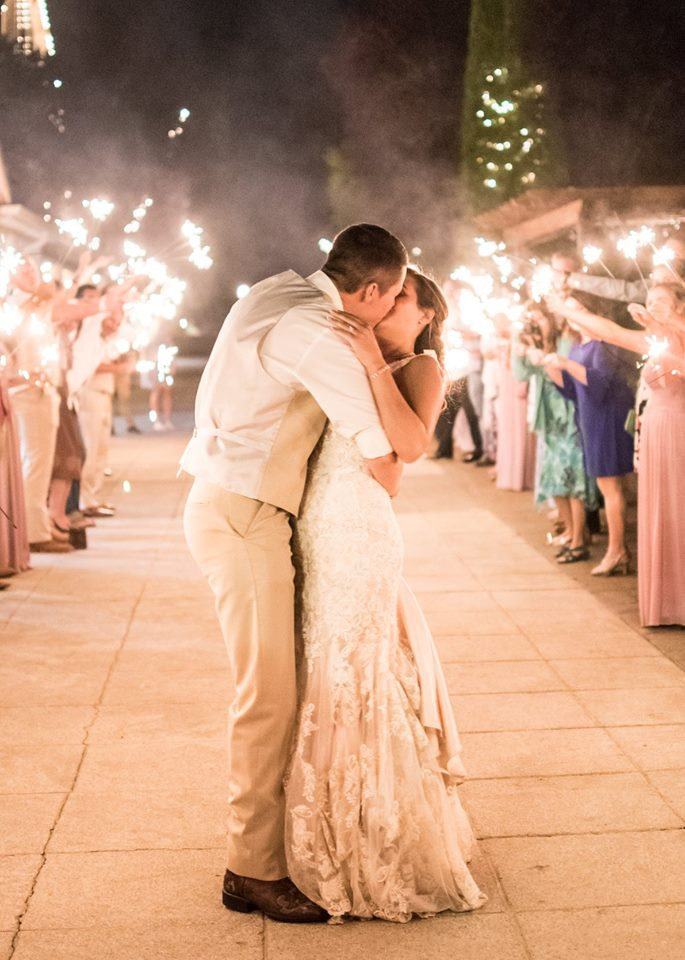 Photo of a sparkler wedding send-off by MyStache Photography. | My Snohomish Wedding | Snohomish Wedding Planning
