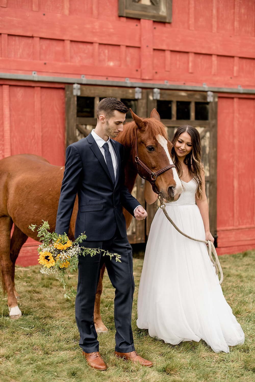A bride and groom lead a horse in front of rustic traveling wedding venue, Tentwood barn. | My Snohomish Wedding | Snohomish Wedding Planning