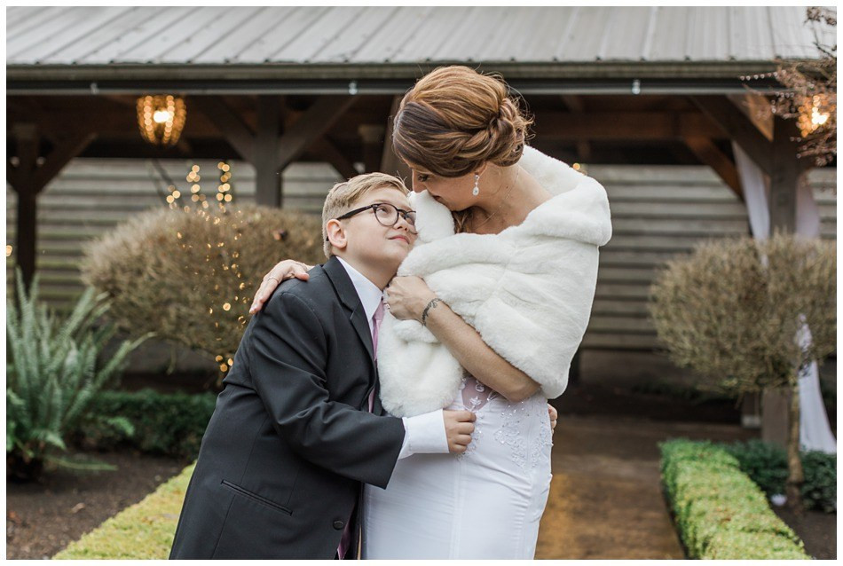 A mother and son look lovingly at each other before her wedding at Hidden Meadows in Snohomish, a wedding venue near Seattle.