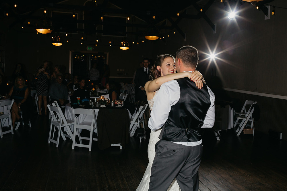 A newlywed couple shares a first dance at a romantic, stormy wedding at Hidden Meadows in Snohomish, a wedding venue near Seattle, WA. | My Snohomish Wedding | Snohomish Wedding Planning