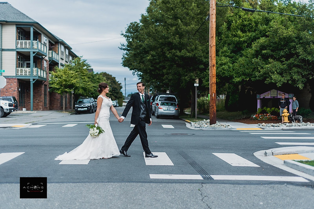 A bride and groom hold hands and walk towards The Feather Ballroom in Snohomish, a wedding venue near Seattle, WA. | My Snohomish Wedding | Snohomish Wedding Planning