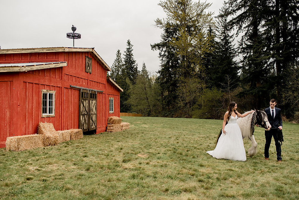 Photo of a bride and groom in front of rustic traveling wedding venue, Tentwood barn. | My Snohomish Wedding | Snohomish Wedding Planning