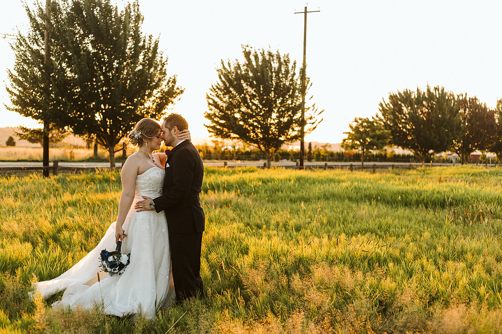 A newlywed couple stand outdoors at sunset during a summer wedding at Hidden Meadows in Snohomish, a wedding venue near Seattle, WA. | My Snohomish Wedding | Snohomish Wedding Planning
