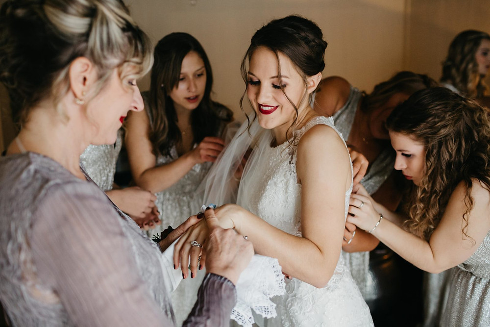 A bride and her bridal party get ready for her romantic, stormy wedding at Hidden Meadows in Snohomish, a wedding venue near Seattle, WA. | My Snohomish Wedding | Snohomish Wedding Planning