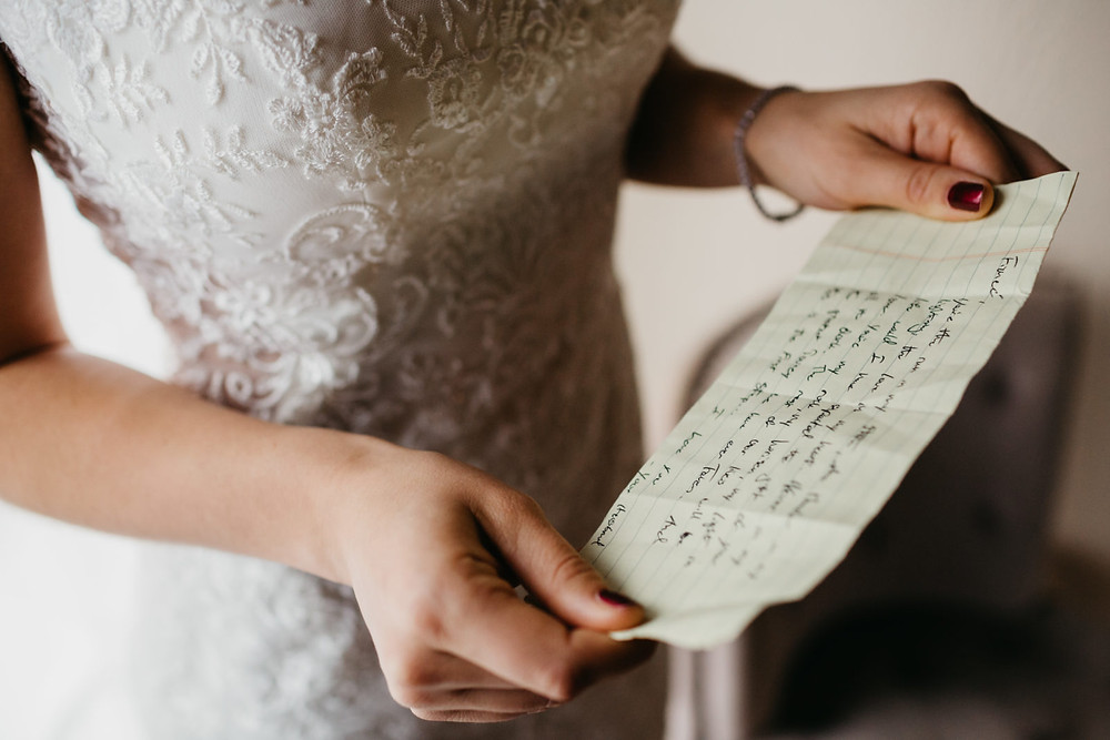 A bride reads a handwritten note before her romantic, stormy wedding at Hidden Meadows in Snohomish, a wedding venue near Seattle, WA. | My Snohomish Wedding | Snohomish Wedding Planning
