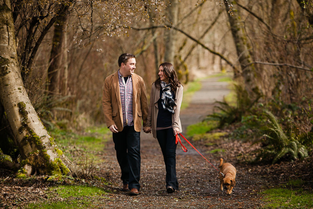 An engaged couple takes a fall walk with their dog. | My Snohomish Wedding | Wedding planning near Seattle, WA.