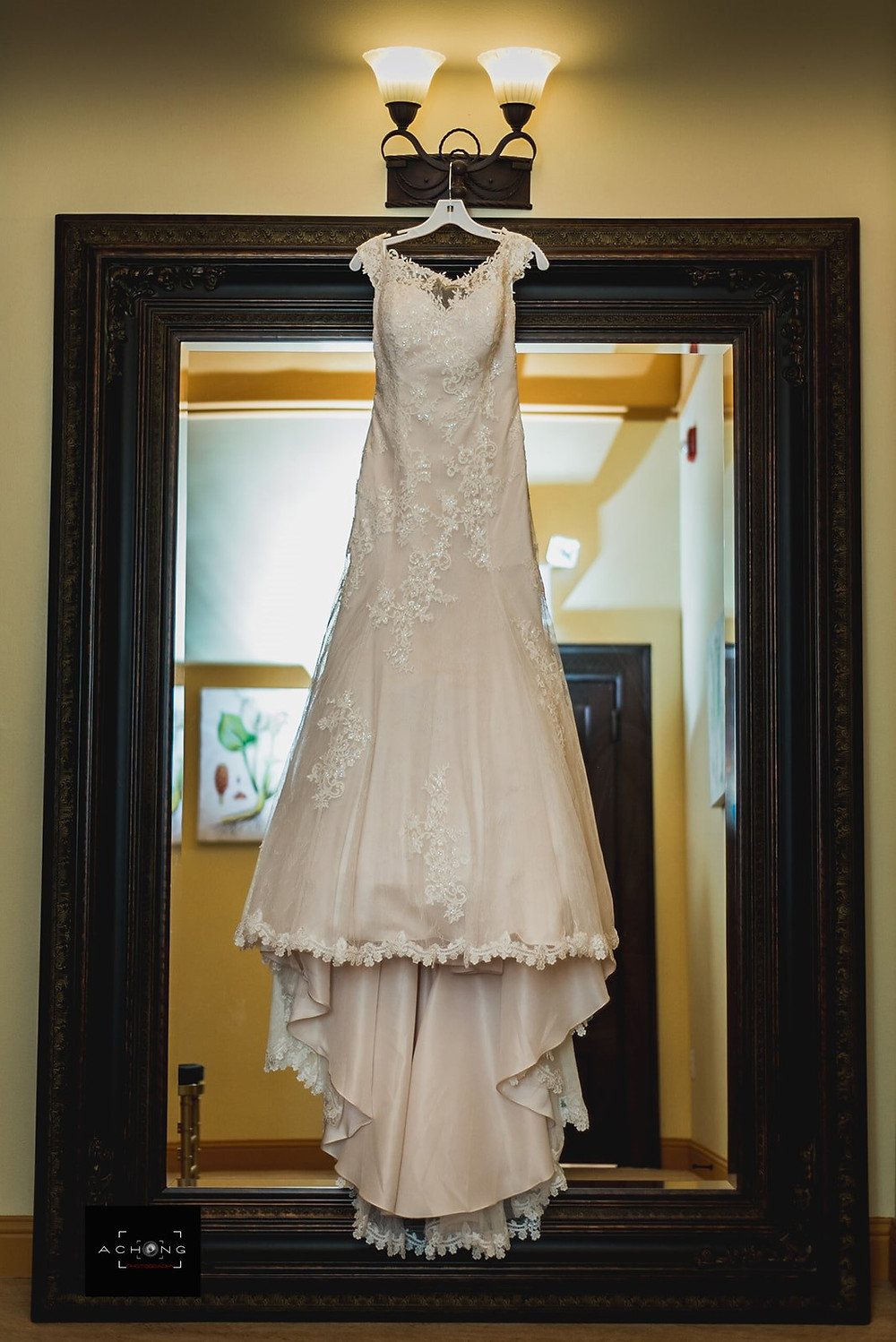 Photo of a hanging wedding dress at The Feather Ballroom in Snohomish, a wedding venue near Seattle, WA. | My Snohomish Wedding | Snohomish Wedding Planning